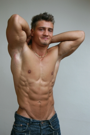 Stretching muscular male model Stock Photo - 15550849