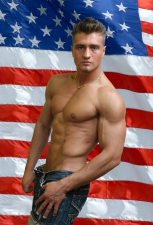 Muscular sexy man with US flag behind Stock Photo - 15540398