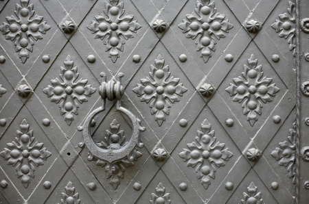 Old pattern gate with a knocker in Konopiste Chateau near Prague, Czech Republic photo