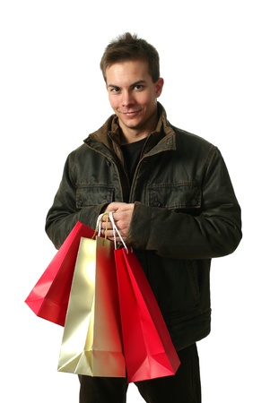 3 persons only: Young sexy man wearing winter clothes with shopping bags isolated on white