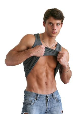 muscle shirt: Hombre joven musculoso mostrando sus abdominales aisladas en blanco