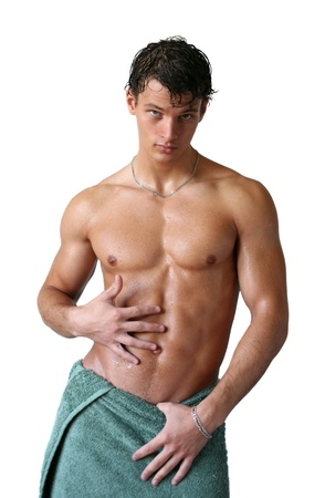 naked abs: Wet muscular sexy man wrapped in the towel isolated on white Stock Photo