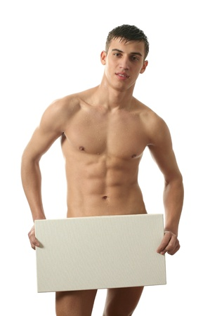 naked abs: Young muscular nude man covering a copy space blank billboard isolated on white