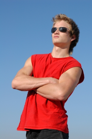 Muscular young man in a red tank top photo