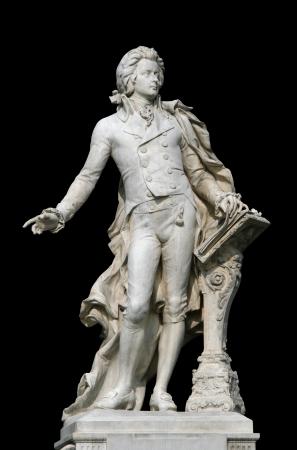 Statue of Wolfgang Amadeus Mozart in the Burggarten garden in Vienna, Austria, isolated on black Banco de Imagens