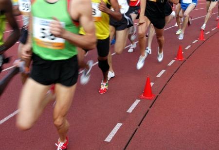 Running athletes at the stadium Banco de Imagens