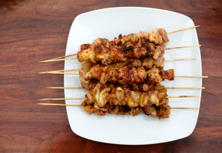 Roasted shish kebab or shashlik on the wooden table photo