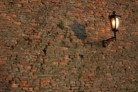 Old lantern on the brick wall at Kalemegdan Fortress in Belgrade, Serbia photo