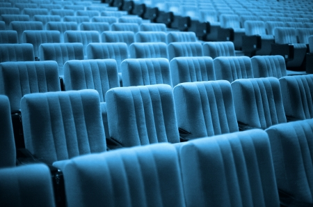 Empty chairs at cinema or theater. Blue Tone photo