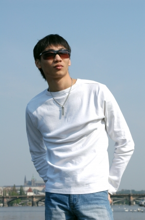 asian man face: Young Asian man with Prague in the background