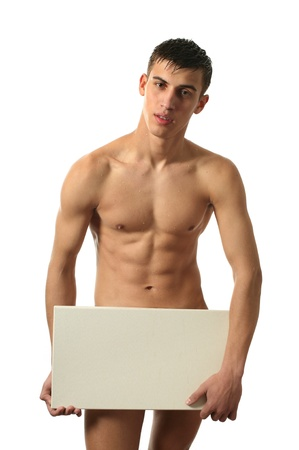 naked people: Nude muscular man covering with a copy space blank board isolated on white