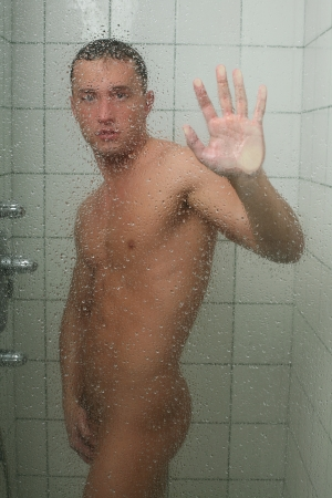 Young sexy man taking shower Stock Photo
