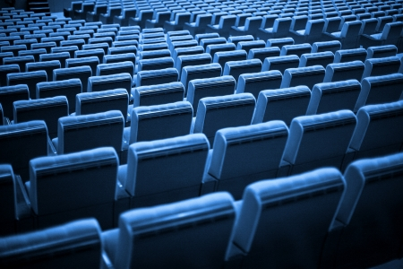 Empty chairs at cinema or theatre. Blue Tone 스톡 콘텐츠