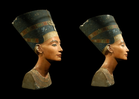 Famous bust of Queen Nefertiti isolated on black Stock Photo