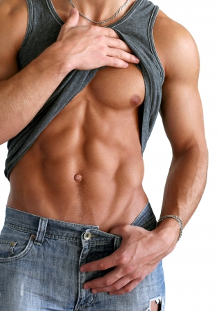 Young muscular man showing his abs isolated on white Reklamní fotografie