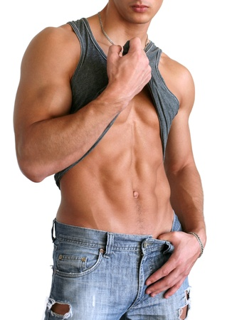 tummy: Young muscular man showing his abs isolated on white Stock Photo