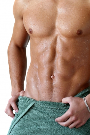 naked abs: Wet muscular torso wrapped in the towel isolated on white Stock Photo