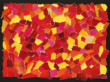 Red and yellow texture made from many pieces of torn paper  photo