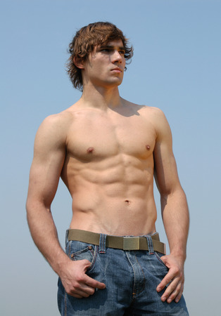 Young sexy bare chested man wearing jeans  photo