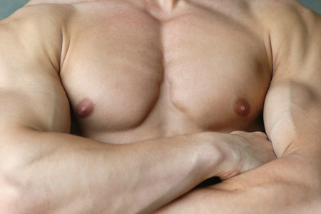 nipple man: Muscular male torso with crossed arms Stock Photo