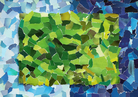 Green texture made from many pieces of torn paper on blue background photo