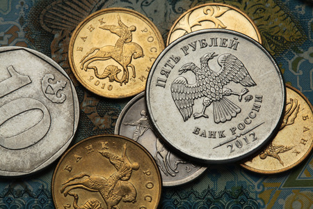 Coins of Russia. Saint George killing the Dragon depicted in Russian kopek coins and Russian two-headed eagle at roubles coin. photo