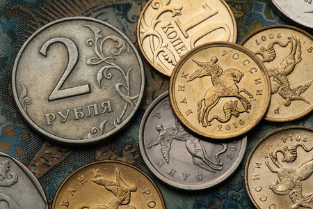 Coins of Russia. Saint George killing the Dragon depicted in Russian kopek coins and Russian two roubles coin. Stock Photo
