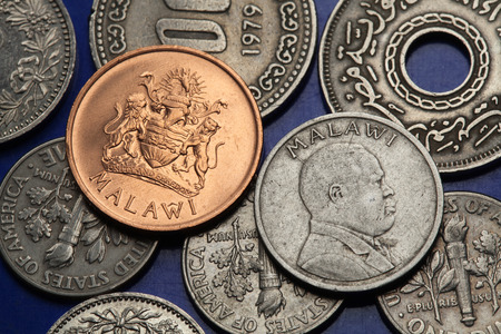 malawian: Coins of Malawi. Malawian coat of arms and Malawian national hero John Chilembwe depicted in Malawian tambala coins.   Stock Photo