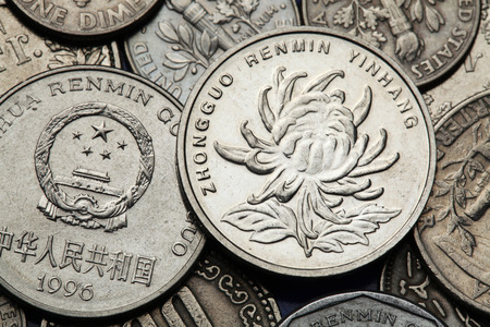 national  emblem: Coins of China. Chrysanthemum flower and the National emblem of China depicted in the Chinese one Yuan coins.  Stock Photo