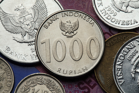 national  emblem: Coins of Indonesia. Indonesian national emblem called the Garuda Pancasila depicted in the Indonesian one thousand rupiah coin. Stock Photo