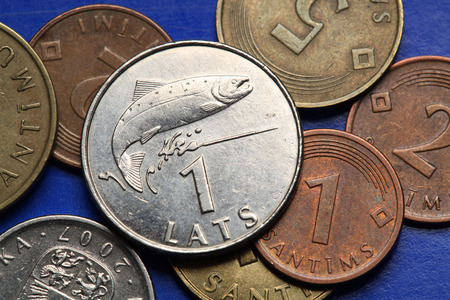 salmon leaping: Coins of Latvia. A leaping salmon symbolised Latvian water depicted in old Latvian one lats coin.  Stock Photo