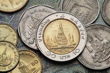 thai temple: Coins of Thailand. Wat Arun Temple in Bangkok, Thailand, depicted in the Thai ten baht coin. Stock Photo