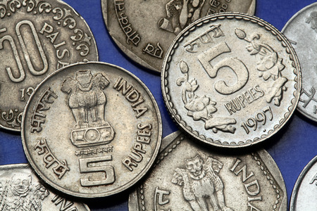 ashoka: Coins of India. The Sarnath Lion Capital of Ashoka served as the state emblem of India depicted in the Indian five rupees coin.  Stock Photo