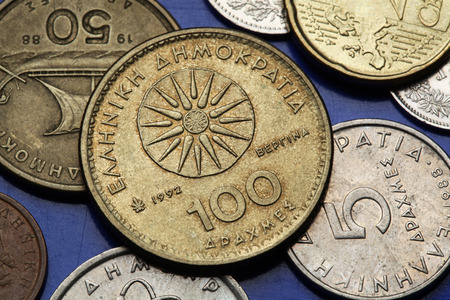 Coins of Greece. The Vergina Sun also known as the Macedonian Star depicted in the old Greek 100 drachma coin. photo