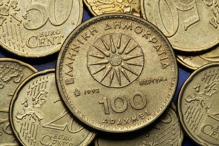 greek coins: Coins of Greece. The Vergina Sun also known as the Macedonian Star depicted in the old Greek 100 drachma coin. Stock Photo