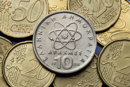 neutron: Coins of Greece. Atom, electron and neutron depicted in the old Greek 10 drachma coin.