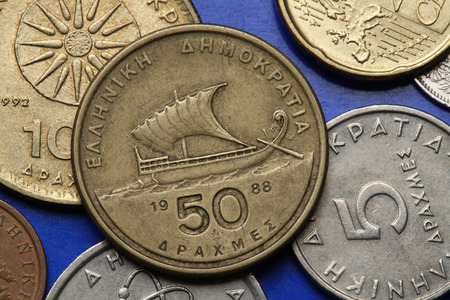 Coins of Greece. Ancient Greek sailing ship depicted in the old Greek 50 drachma coin. photo