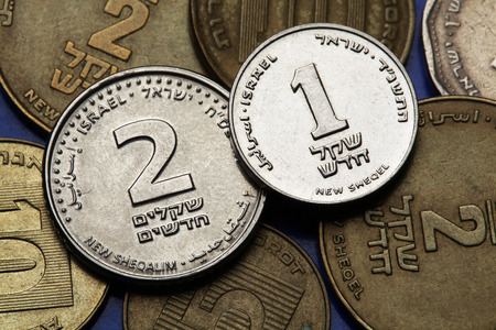 sheqalim: Coins of Israel. Israeli one and two new shekels coins.