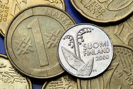 finnish markka: Coins of Finland. Lily of the valley (Convallaria majalis) depicted in the Finnish 10 penni coin and Finnish one markka coin. Stock Photo