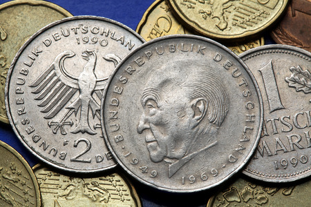 statesman: Coins of Germany. German statesman Konrad Adenauer and the German eagle depicted in old Deutsche Mark coins.