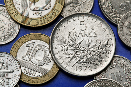 bimetallic: Coins of France. Olive and oak branches depicted in the old five French franc coin.
