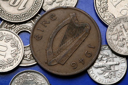 Coins of Ireland. Celtic harp depicted in the old Irish one penny coin (1946). photo