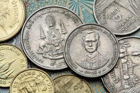 ix portrait: Coins of Thailand. King Bhumibol Adulyadej of Thailand and the Royal Golden Jubilee Emblem depicted in the old Thai baht coins.