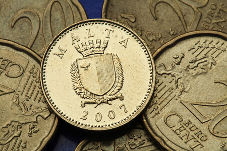 Coins of Malta. Maltese national coat of arms depicted in the old Maltese one cent coin. photo
