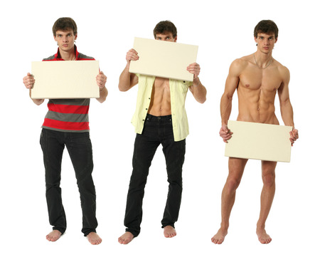 Three young sexy men holding copy space blank signs isolated on white photo
