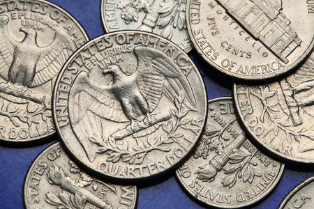 25 cents: Coins of USA. Bald eagle (Haliaeetus leucocephalus) depicted on the US quarter coin. Stock Photo