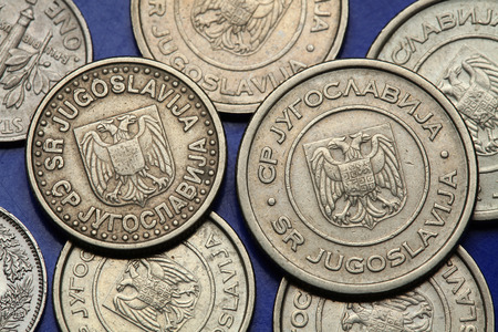 serb: Coins of Yugoslavia. Yugoslav national coats of arms depicted on the Yugoslav novi dinar coins (2002).