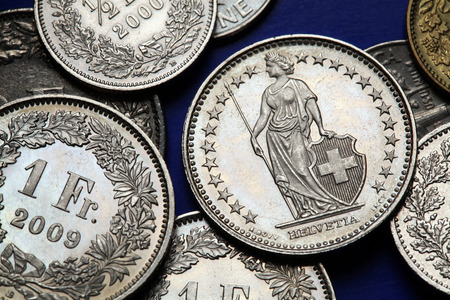 helvetia: Coins of Switzerland. Standing Helvetia depicted in the Swiss one franc coins. Stock Photo