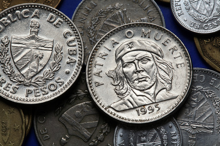national hero: Coins of Cuba. Cuban national hero Ernesto Che Guevara depicted in the Cuban three peso coin. Stock Photo