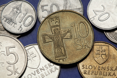 11th: Coins of Slovakia. Bronze cross from the 11th century depicted on the Slovak 10 koruna coin. Stock Photo